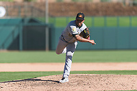 Mesa Solar Sox relief pitcher Angel Duno (79), of the Oakland Athletics organization, follows through on his delivery during an Arizona Fall League game against the Glendale Desert Dogs at Camelback Ranch on October 15, 2018 in Glendale, Arizona. Mesa defeated Glendale 8-0. (Zachary Lucy/Four Seam Images)