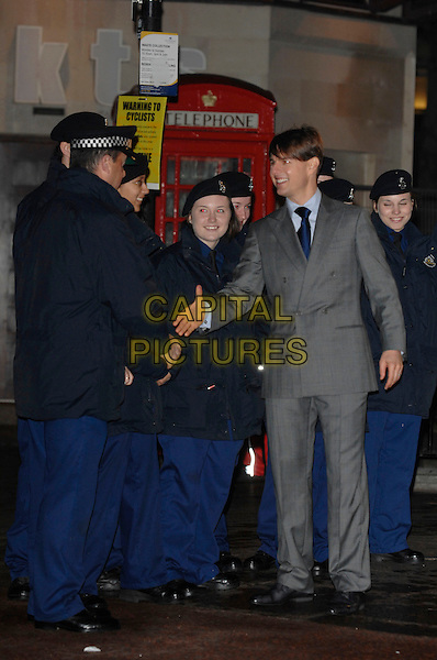 """TOM CRUISE.arrives at The Times BFI 51st London Film Festival gala screening and world premiere of  """"Lions for Lambs"""" at the Odeon Leicester Square.22nd October 2007 London, England.full length meeting police shaking hands.CAP/PL.©Phil Loftus/Capital Pictures"""
