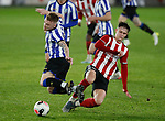 Jake Young of Sheffield Utd tackles Fraser Preston of Sheffield Wednesday during the Professional Development League match at Bramall Lane, Sheffield. Picture date: 26th November 2019. Picture credit should read: Simon Bellis/Sportimage