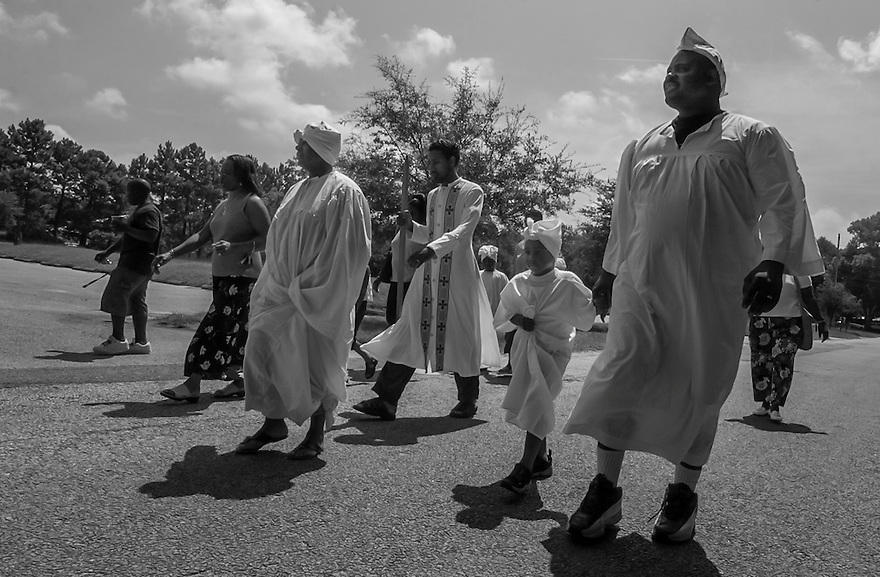 Members of the Mt. Calvary Missionary Baptist Church march to the river near the church for a traditional Gullah Geechee river baptism ceremony.