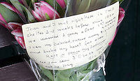 Pictured: The flowers left at the bus shelter in the centre of Neath south Wales.<br />