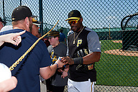 Pittsburgh Pirates Starling Marte (6) signs autographs after the teams first Spring Training practice on February 18, 2019 at Pirate City in Bradenton, Florida.  (Mike Janes/Four Seam Images)