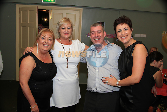 Theresa Reilly, Haylish Murtagh, Patrick Reilly and Joanne Lynch at Theresa's 50th (and Orlith Reilly's 21st) in the Star and Crescent..Picture: Shane Maguire / www.newsfile.ie