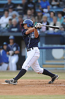Asheville Tourists designated hitter Michael Benjamin #18 swings at a pitch during a game against the Delmarva Shorebirds at McCormick Field on April 5, 2014 in Asheville, North Carolina. The Tourists defeated the Shorebirds 5-3. (Tony Farlow/Four Seam Images)