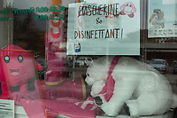 Switzerland. Canton Ticino. Chiasso. Chemistry shop window. A sign informs customers that the pharmacy has no more masks but hand sanitizers to sell for protection against Coronavirus (also called Covid-19). Hand sanitizer is a liquid generally used to decrease infectious agents on the hand. A smiley (sometimes called a happy face or smiley face) is a stylized representation of a smiling humanoid face that is a part of popular culture worldwide. 9.03.2020 © 2020 Didier Ruef