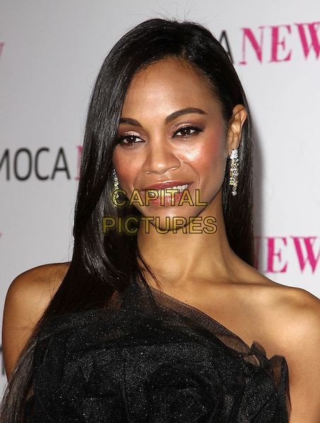 ZOE SALDANA .At MOCA's 30th Anniversary Gala held at MOCA, Los Angeles, California, USA, 14th November 2009. .portrait headshot earrings dangly black strapless tulle .CAP/ADM/KB.©Kevan Brooks/AdMedia/Capital Pictures.