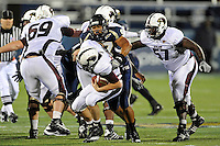 6 November 2010:  FIU defensive end Tourek Williams (97) sacks Louisiana-Monroe quarterback Kolton Browning (15) in the second quarter as the FIU Golden Panthers defeated the University of Louisiana-Monroe Warhawks, 42-35 in double overtime, at FIU Stadium in Miami, Florida.