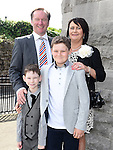 Osgar Sullivan from LeCheile school who was confirmed in St Mary's church pictured with dad Cyril, mam Breda and brother Bartley. Photo:Colin Bell/pressphotos.ie