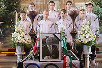 Young football players mourn behind the coffin of late soccer player Jeno Buzanszky during his funeral in Budapest, Hungary on January 30, 2015. ATTILA VOLGYI
