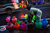 Local residents fill up water buckets at the water pump in early hours of the day in Vyasarpadi slum in Chennai, Tamil Nadu, India.  Photo by Sanjit Das/Panos