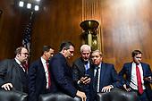 WASHINGTON, DC - SEPTEMBER 27: A group including Sen. Ted Cruz (R-Tex.), center,Sen. John Cornyn (R-Tex.) (holding phone) and Sen. Lindsey O. Graham (R-S.C.) and other staff at a Senate Judiciary Committee hearing on Thursday, September 27, 2018 on Capitol Hill. (Matt McClain/Pool/The Washington Post)