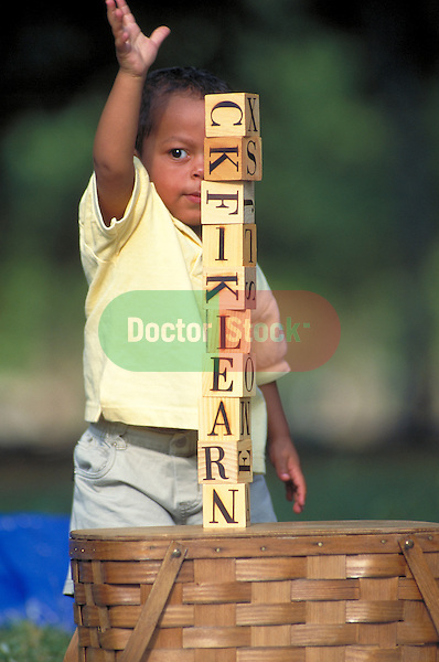 young boy playing with toy blocks