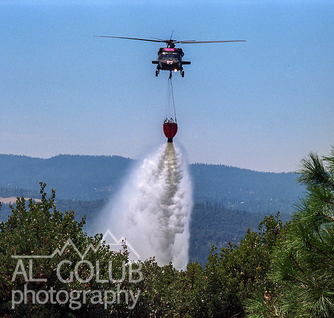 August 16, 1996 Sonora, California  -- Rogge Fire – U.S. military helicopter makes water drop on Rogge fire.  The Ackerson and Rogge Fires combined to char 60,000 acres in 1996. The Rogge Fire was centered on the north side of the Tuolumne River, burning over Jawbone Ridge and Cherry Creek areas.