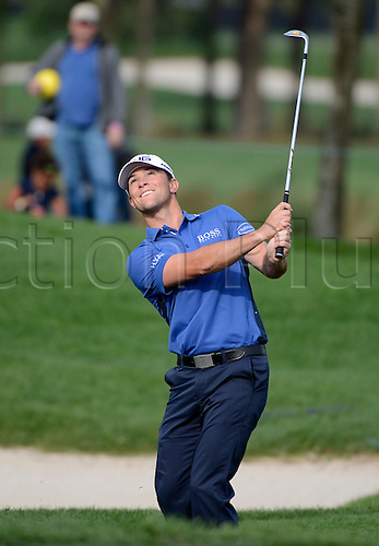 02.03.2013 Florida, USA. Luke Guthrie smiles as he makes a chip shot during the third round of the Honda Classic at the PGA National Resort & Spa in Palm Beach Gardens, FL.
