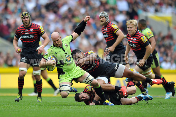 Sam Dickinson is tackled to ground. Aviva Premiership Final, between Saracens and Northampton Saints on May 31, 2014 at Twickenham Stadium in London, England. Photo by: Patrick Khachfe / JMP
