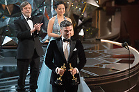 Oscar Isaac, Mark Hamill and Kelly Marie Tran present the Oscar&reg; for Best animated short film during the live ABC Telecast of The 90th Oscars&reg; at the Dolby&reg; Theatre in Hollywood, CA on Sunday, March 4, 2018.<br /> *Editorial Use Only*<br /> CAP/PLF/AMPAS<br /> Supplied by Capital Pictures
