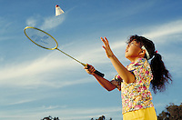 HISPANIC GIRL PRACTISING BADMINTON. HISPANIC GIRL. OAKLAND CALIFORNIA USA.