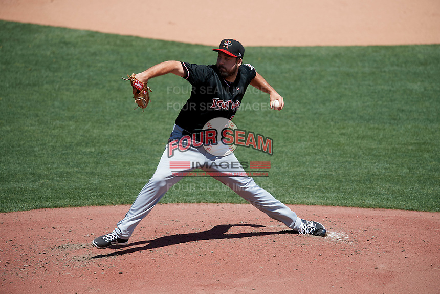 Albuquerque Isotopes starting pitcher Harrison Musgrave (32) delivers a pitch to the plate against the Salt Lake Bees  in Pacific Coast League action at Smith's Ballpark on June 11, 2017 in Salt Lake City, Utah. The Bees defeated the Isotopes 6-5. (Stephen Smith/Four Seam Images)