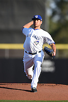 Dunedin Blue Jays  pitcher Jesse Hernandez (21), on rehab assignment, during a game against the Brevard County Manatees on April 11, 2014 at Florida Auto Exchange Stadium in Dunedin, Florida.  Brevard County defeated Dunedin 5-2.  (Mike Janes/Four Seam Images)
