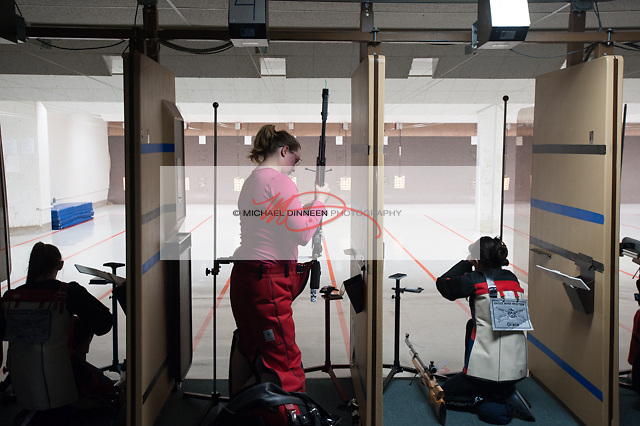 Chugiak's Dana Gay prepares for her round of shooting at the Chugiak vs. Eagle River riflery match Friday, Oct. 21, 2016.  Photo for the Star by Michael Dinneen