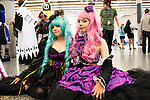 Colorful gothic lolitas pose patiently at Montreal Otakuthon.