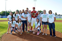 Batavia Muckdogs outfielder Austin Dean #3 poses with the Batavia Lady Devils Section V Championship Softball team after the ceremonial first pitch before a game against the Auburn Doubledays on June 18, 2013 at Dwyer Stadium in Batavia, New York.  Batavia defeated Auburn 10-2.  (Mike Janes/Four Seam Images)
