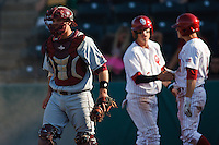 Catcher Myles Parma (23) walks off after missing the tag at home as OU players celebrate the score behind him during the NCAA matchup between the University of Arkansas-Little Rock Trojans and the University of Oklahoma Sooners at L. Dale Mitchell Park in Norman, Oklahoma; March 11th, 2011.  Oklahoma won 11-3.  Photo by William Purnell/Four Seam Images