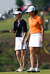 HAIKOU, CHINA - OCTOBER 30:  Lorena Ochoa (R) of Mexico and Catherine Zeta-Jones stand on the 9th green during day four of the Mission Hills Start Trophy tournament at Mission Hills Resort on October 30, 2010 in Haikou, China. The Mission Hills Star Trophy is Asia's leading leisure liflestyle event and features Hollywood celebrities and international golf stars. Photo by Victor Fraile / The Power of Sport Images