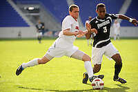 Buck Tufty (10) of the Louisville Cardinals is defended by George Hodge (3) of the Providence Friars during the finals of the Big East Men's Soccer Championship at Red Bull Arena in Harrison, NJ, on November 14, 2010.