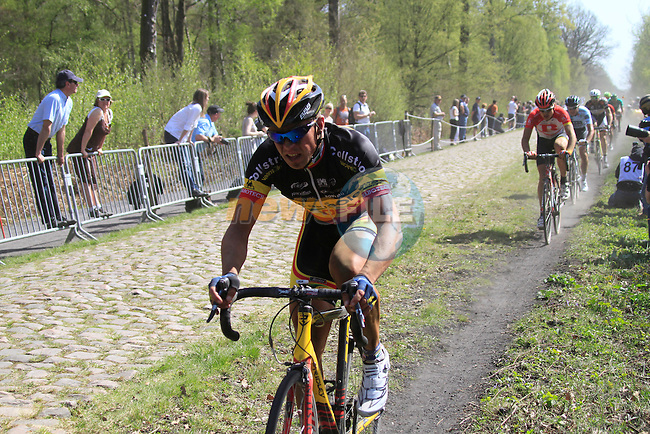 Stijn Devolder (BEL) Vacansoleil-DCM races through the Forest of Arenberg on Pave Section 16 during the 109th edition of the Paris-Roubaix cycle race, 10th April 2011 (Photo by Eoin Clarke/NEWSFILE)