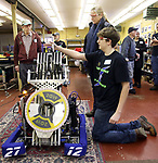 WOODBURY CT. 16 March 2018-031619SV08-Patrick Boylan, 17, of Woodbury gets the robot ready for a demonstration during the Power Surge 4-H Robotocs team open house at the Power Station Braxton Engineering Building in Woodbury Saturday.<br /> Steven Valenti Republican-American