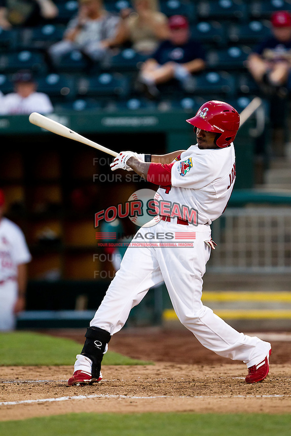 Daryl Jones (4) of the Springfield Cardinals follows through his swing during a game against the Tulsa Drillers at Hammons Field on July 18, 2011 in Springfield, Missouri. Tulsa defeated Springfield 13-8. (David Welker / Four Seam Images)