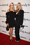 CULVER CITY, CA - OCTOBER 21: TV personality Camille Grammer (L) and actress Kimber Sissons attend the Dorit Kemsley Hosts Preview Event For Beverly Beach By Dorit at the Trunk Club on October 21, 2017 in Culver City, California.