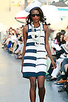 Aminata Niaria walks runway in a Douglas Hannant Resort 2012 outfit, on the USS Intrepid, June 7, 2011.