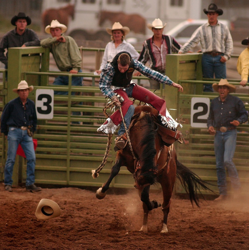 Saddle bronc riding at the Snowmass rodeo. Snowmass, Colorado. © Michael Brands. 970-379-1885.