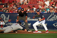 Reading Fightin Phils first baseman Brock Stassi (28) waits for a throw as David Dahl (1) dives back with umpire John Libka looking on during a game against the New Britain Rock Cats on August 7, 2015 at FirstEnergy Stadium in Reading, Pennsylvania.  Reading defeated New Britain 4-3 in ten innings.  (Mike Janes/Four Seam Images)