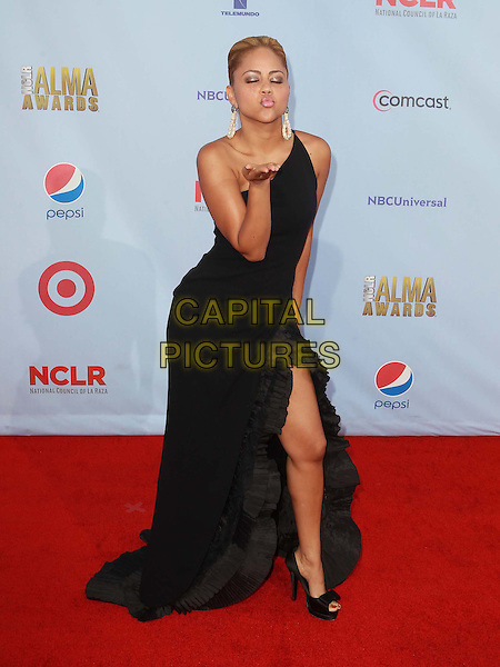 Kat DeLuna.2012 NCLR ALMA Awards - arrivals, held at The Pasadena Civic Auditorium, Pasadena, California USA..16th September 2012.full length black one shoulder dress slit split hand arm blowing kiss eyes closed .CAP/ADM/KB.©Kevan Brooks/AdMedia/Capital Pictures.