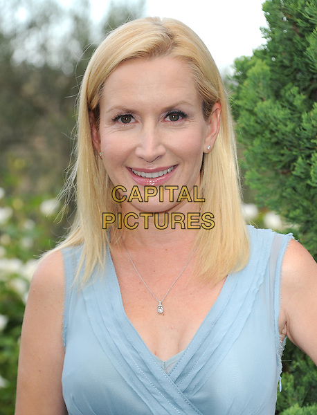 Angela Kinsey<br /> 6th Annual Oceana SeaChange Gala held at a Private Villa, Laguna Beach, California, USA.     <br /> August 18th, 2013<br /> headshot portrait blue sleeveless <br /> CAP/DVS<br /> &copy;DVS/Capital Pictures