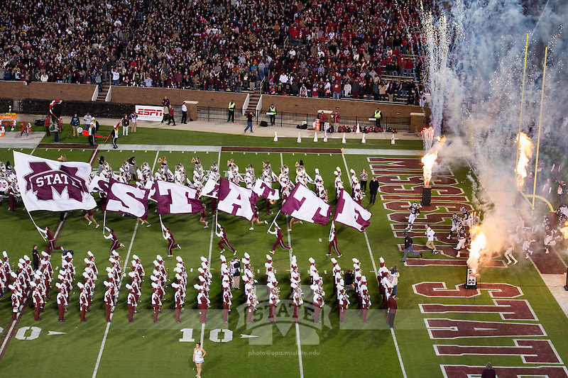 Cheerleaders running on the field during pregame. (photo by Megan Bean / © Mississippi State University)