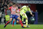 Club Atletico de Madrid's Rodrigo Hernandez (L) and Futbol Club Barcelona's Luis Suarez  during La Liga match. November 24,2018. (ALTERPHOTOS/Alconada)