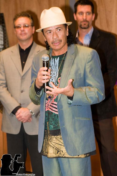 Hard Rock Hotel & Casino cuts ribbon on the new Joint, April 14, 2009, with Las Vegas Mayor Oscar Goodman and recording artist and resident headliner Carlos Santana