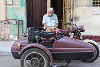 Man sitting on the street, waiting for a ride, Centro Habana