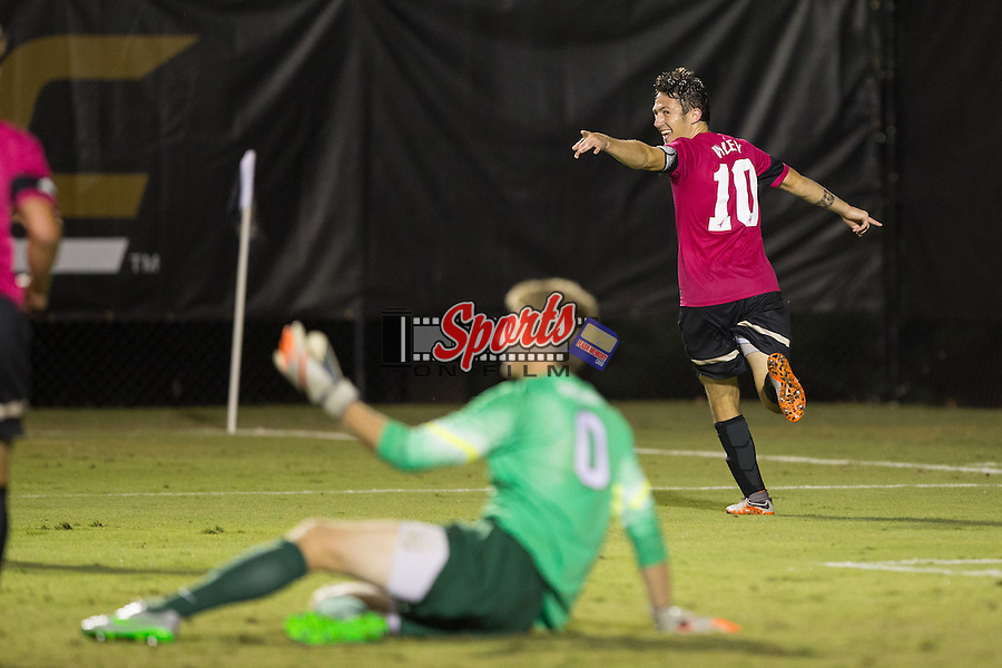Michael Gamble (10) of the Wake Forest Demon Deacons celebrates after scoring a goal during second half action against the Syracuse Orange at Spry Soccer Stadium on September 19, 2015 in Winston-Salem, North Carolina.  The Demon Deacons defeated the Orange 3-1.  (Brian Westerholt/Sports On Film)