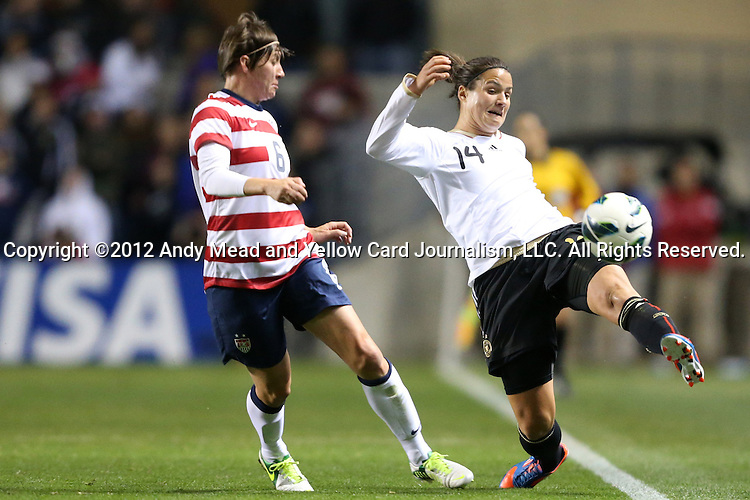 20 October 2012: Dzsenifer Marozsan (GER) (14) is defended by Amy LePeilbet (USA) (6). The United States Women's National Team played the Germany Women's National Team at Toyota Park in Bridgeview, Illinois in a women's international friendly soccer match. The game ended in a 1-1 tie.