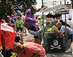 One of the crew members of an Entry leaping for joy before the start of The Great Saugerties Bed Race on Partition Street in Saugerties, NY on Saturday, August 6, 2011. Photo by Jim Peppler. Copyright Jim Peppler/2011.