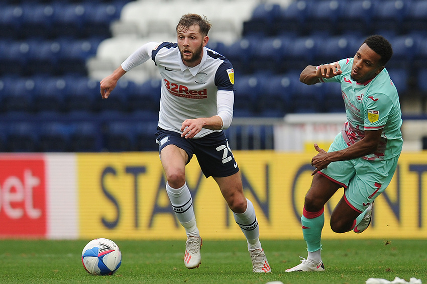 Preston North End's Tom Barkhuizen under pressure from Swansea City's Korey Smith<br /> <br /> Photographer Kevin Barnes/CameraSport<br /> <br /> The EFL Sky Bet Championship - Preston North End v Swansea City - Saturday September 12th 2020 - Deepdale - Preston<br /> <br /> World Copyright © 2020 CameraSport. All rights reserved. 43 Linden Ave. Countesthorpe. Leicester. England. LE8 5PG - Tel: +44 (0) 116 277 4147 - admin@camerasport.com - www.camerasport.com