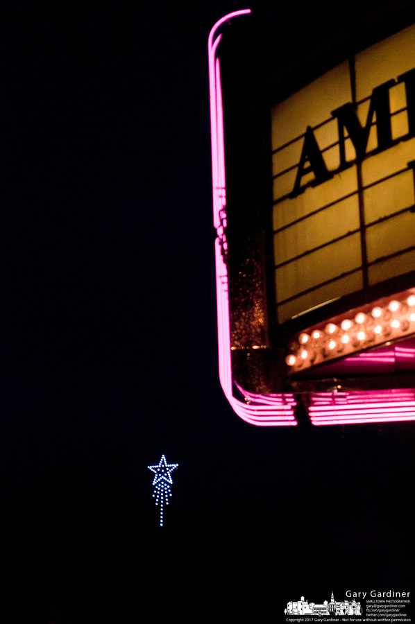 The Christmas star hangs over the intersection of Main and State Streets in Uptown Westerville framed by the pink neon marquee of the Amish furniture store, formerly a movie theater.