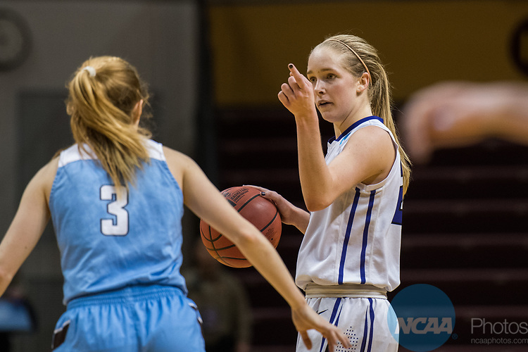 GRAND RAPIDS, MI - MARCH 18: Ali Doswell (23) of Amherst College gives her team the play during the Division III Women's Basketball Championship held at Van Noord Arena on March 18, 2017 in Grand Rapids, Michigan. Amherst College defeated Tufts University 52-29 for the national title. (Photo by Brady Kenniston/NCAA Photos via Getty Images)