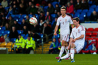 Wednesday 05 March 2014<br /> Pictured:Joe Allen ( right ) crosses the ball <br /> Re: International friendly Wales v Iceland at the Cardiff City Stadium, Cardiff,Wales UK