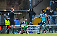 Referee Robert Jones awards a penalty after Sido Jombati (right) of Wycombe Wanderers fouls Francois Zoko of Yeovil Town during the Sky Bet League 2 match between Wycombe Wanderers and Yeovil Town at Adams Park, High Wycombe, England on 14 January 2017. Photo by Andy Rowland / PRiME Media Images.